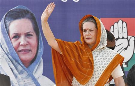 Chief of India's ruling Congress party Sonia Gandhi waves to her supporters during an election campaign rally ahead of state assembly elections at Rajkot, in the western Indian state of Gujarat October 3, 2012. REUTERS/Amit Dave