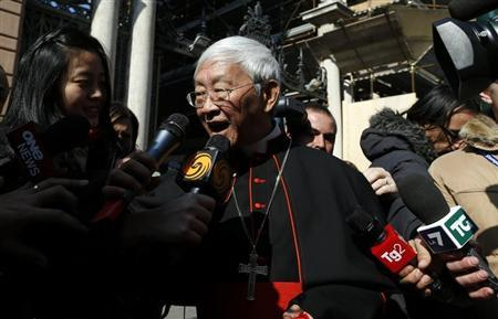 Cardinal Joseph Zen Ze-kiun of China is surrounded by media as he walks near St. Peter square in Rome February 28, 2013. REUTERS/Alessandro Bianchi
