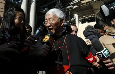 Cardinal Joseph Zen Ze-kiun of China is surrounded by media as he walks near St. Peter square in Rome February 28, 2013. REUTERS/Alessandro Bianchi/Files