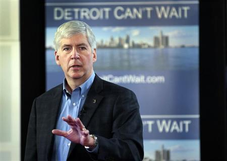 Michigan Governor Rick Snyder talks about the city of Detroit being in a financial emergency state during a meeting with an invited audience at Wayne State University in Detroit, Michigan March 1, 2013. REUTERS/ Rebecca Cook
