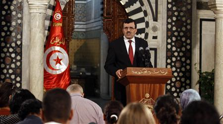 Tunisia's Prime Minister Ali Larayedh speaks during a news conference in Tunis August 27, 2013. REUTERS/Zoubeir Souissi