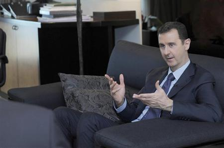 Syria's President Bashar al-Assad speaks during an interview with a Russian newspaper in Damascus, in this handout photograph distributed by Syria's national news agency SANA on August 26, 2013. REUTERS/SANA/Handout via Reuters