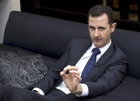 Syria's President Bashar al-Assad speaks during an interview with a German newspaper in Damascus, in this handout photograph distributed by Syria's national news agency SANA, June 17, 2013 . REUTERS/SANA/Handout via Reuters