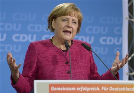 German Chancellor and head of the Christian Democratic Union (CDU) Angela Merkel delivers her speech at an election campaign in Winsen near by Hamburg, August 27, 2013. REUTERS/Fabian Bimmer