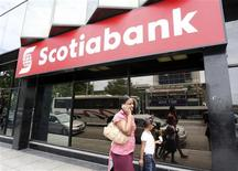 People walk past a branch of Scotiabank in Port of Spain April 16, 2009. REUTERS/Jose Miguel Gomez