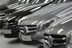 Mercedes-Benz A-class cars are displayed in a dealership of German car manufacturer Daimler in Paris, July 30, 2013. REUTERS/Christian Hartmann
