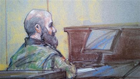 U.S. Army psychiatrist Major Nidal Hasan is pictured in court in Fort Hood, Texas in this August 23, 2013 court sketch. REUTERS/ Brigitte Woosley