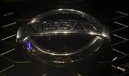 "A company logo is seen on the newly-unveiled Nissan ""Terrano"" compact sport utility vehicle during a news conference in Mumbai August 20, 2013. REUTERS/Danish Siddiqui"