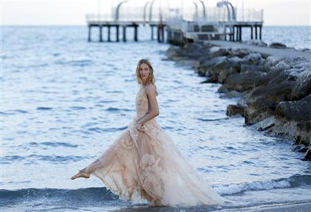 Eva Riccobono, actress and model, poses a day before the 70th Venice Film Festival in Venice August 27, 2013. REUTERS/Alessandro Bianchi