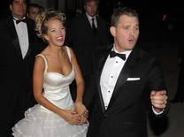 Canadian singer Michael Buble and his bride Argentine actress Luisana Lopilato pose for photographers after their religious wedding ceremony at the Villa Maria palace in Marcos Paz, outskirts of Buenos Aires in this April 2, 2011 file photo. REUTERS/Enrique Marcarian