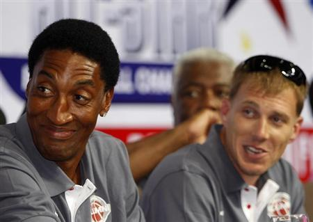 Former NBA Chicago Bulls player Scottie Pippen (L) smiles during a news conference inside a mall of Asia Arena in Manila, July 17, 2012. REUTERS/Romeo Ranoco