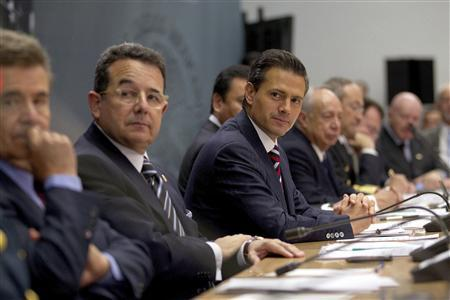 Mexico's President Felipe Pena Nieto attends a security meeting in Mexico City August 27, 2013. REUTERS/Mexico Presidency/Handout via Reuters