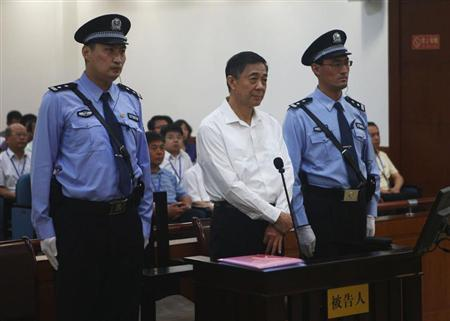 Disgraced Chinese politician Bo Xilai stands trial inside the court in Jinan, Shandong province August 22, 2013, in this photo released by Jinan Intermediate People's Court. REUTERS/Jinan Intermediate People's Court/Handout via Reuters