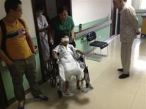 A six-year-old boy, whose eyes were gouged out, is pushed in a wheelchair at a hospital in Taiyuan, Shanxi province August 27, 2013. REUTERS/Stringer