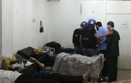 U.N. chemical weapons experts visit a hospital where wounded people affected by an apparent gas attack are being treated, in the southwestern Damascus suburb of Mouadamiya, August 26, 2013. REUTERS/Abo Alnour Alhaji