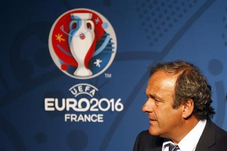 Michel Platini, UEFA President reacts in front of the UEFA EURO 2016 logo at a news conference in Paris June 26, 2013. REUTERS/Charles Platiau