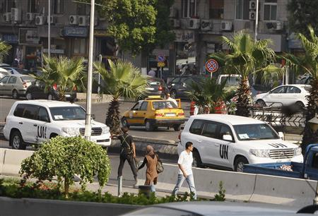 U.N. vehicles, carrying a team of United Nations chemical weapons experts, return to their hotel in Damascus August 28, 2013. REUTERS/Khaled al-Hariri