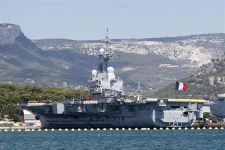 The French nuclear-powered aircraft carrier Charles de Gaulle is seen in the Mediterranean port in Toulon, August 28, 2013. REUTERS/Stringer