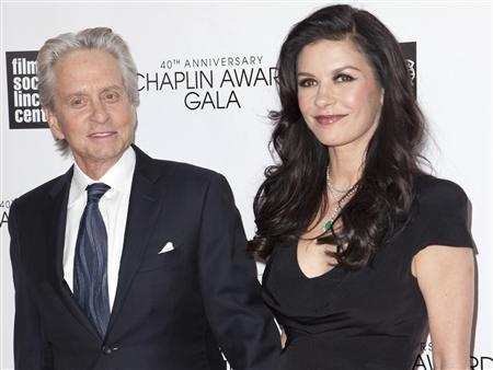 Michael Douglas (L) and Catherine Zeta-Jones attend the 40th Anniversary Chaplin Award Gala at Lincoln Center in New York in this file photo taken April 22, 2013. Douglas and Zeta-Jones, both Oscar winners and among Hollywood's most high-profile couples, have separated in what could spell the end of their nearly 13-year marriage, People magazine reported on Wednesday. REUTERS/Andrew Kelly/Files