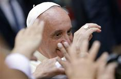 Pope Francis waves as he arrives for a private visit at the Saint Agostino church in Rome August 28, 2013. REUTERS/Max Rossi