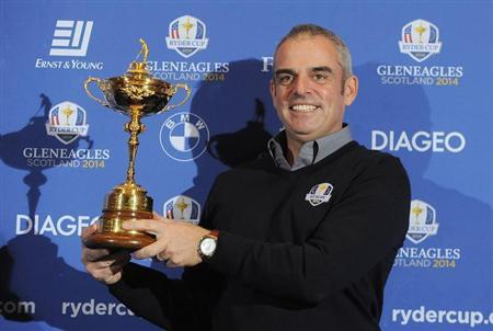 Paul McGinley of Ireland poses with the Ryder Cup during a news conference after being named the European Ryder Cup captain at the St. Regis in Saadiyat Islands in Abu Dhabi January 15, 2013. REUTERS/Ben Job