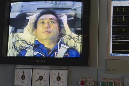 Japanese astronaut Koichi Wakata is seen on a monitor during a training exercise in a cetrifuge at the Star City space centre outside Moscow, August 9, 2013. REUTERS/Sergei Remezov