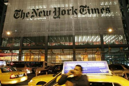 A man speaks on his mobile phone in front of the New York Times building in New York City May 21, 2009. REUTERS/Joel Boh