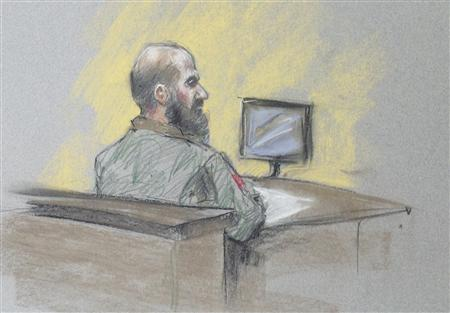 U.S. Army Major Nidal Hasan looks at panel president during reading of his sentence, the first time Hasan looked in the direction of the panel, in this courtroom sketch in Fort Hood, Texas, August 28, 2013. A military jury on Wednesday sentenced U.S. Army Major Nidal Hasan to death by lethal injection for killing 13 people and wounding 31 others in a November 2009 shooting rampage at Fort Hood, Texas. REUTERS/Brigitte Woosley