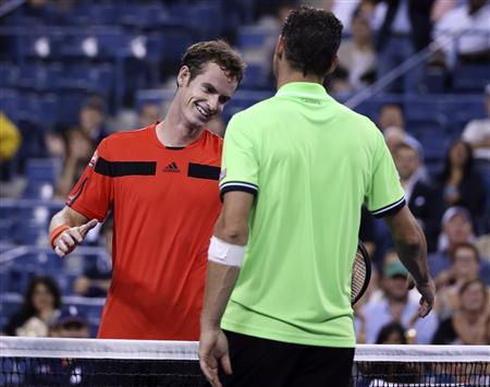 Andy Murray of Britain shakes hands at the net with Michael Llodra of France after winning his opening match at the U.S. Open tennis championships in New York, August 28, 2013. REUTERS/Shannon Stapleton