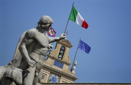 The Italian national flag flutters atop of the Quirinale presidential palace in Rome June 26, 2013. REUTERS/Max Rossi
