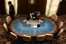 A high angle view of croupiers prepare to greet visitors at Sands Macau casino in Macau, a former Portuguese enclave before reverting to Chinese rule, in this May 18, 2004 file photo.REUTERS/Bobby Yip/Files