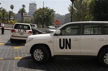 U.N. vehicles carrying a team of United Nations chemical weapons experts leave the hotel where they are staying at in Damascus August 29, 2013. REUTERS/Khaled al-Hariri