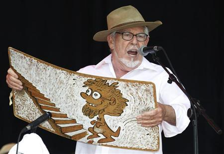 Australian singer Rolf Harris performs with his wobbleboard at the Glastonbury Festival 2010 in south west England, June 25, 2010 file photo. REUTERS/Luke MacGregor