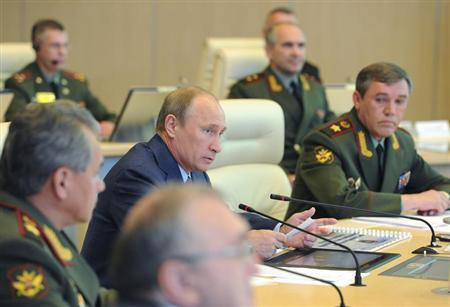 Russia's President Vladimir Putin (C) attends a conference at the main operation centre of the Russian armed forces, with Defence Minister Sergei Shoigu (L) and armed forces Chief-of-Staff Valery Gerasimov (R) in Moscow, June 6, 2013. REUTERS/Michael Klimentyev/RIA Novosti/Kremlin