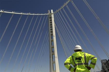 A man looks over the new Bay Bridge's Self-Anchored Suspension tower in San Francisco, California August 26, 2013. REUTERS/Robert Galbraith