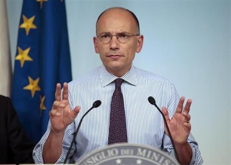 Italian Prime Minister Enrico Letta gestures during a news conference at the end of a cabinet meeting at Chigi palace in Rome August 28, 2013. REUTERS/Tony Gentile