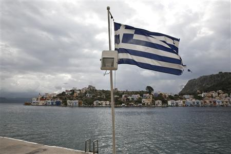 A Greek flag flutters at the port of the Greek southeastern island of Kastelorizo April 15, 2013. Picture taken April 15, 2013. REUTERS/Yorgos Karahalis