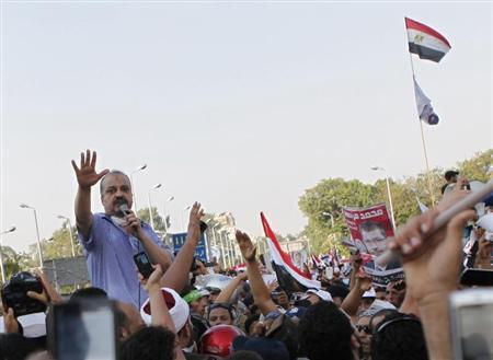 Brotherhood leader Mohamed El Beltagy (L) shouts slogans with protesters supporting deposed Egypt's President Mohamed Mursi as they gather outside the Republican Guard barracks where Mursi is held in Cairo July 5, 2013. REUTERS/Amr Abdallah Dalsh