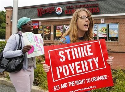 Strikers march outside a Wendy's restaurant in Boston, Massachusetts August 29, 2013, as a part of a nationwide fast food workers' strike asking for $15 per hour wages and the right to form unions. REUTERS-Brian Snyder