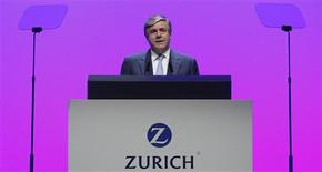 Zurich Financial Services Group newly elected Chairman Josef Ackermann delivers his speech during his company's annual general meeting in Zurich in this March 29, 2012 file photo. REUTERS/Christian Hartmann/Files