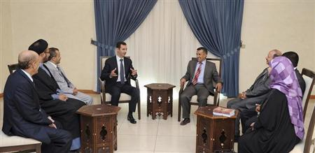 Syria's President Bashar al-Assad (center L) speaks during a meeting with the Yemeni delegation in Damascus in this handout photograph distributed by Syria's national news agency SANA on August 29, 2013. REUTERS/SANA/Handout via Reuters