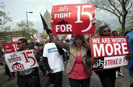 A group of workers and labor activists march down West Grand Boulevard as they demand a raise in the minimum wage for fast food workers in Detroit, Michigan May 10, 2013. REUTERS/Rebecca Cook