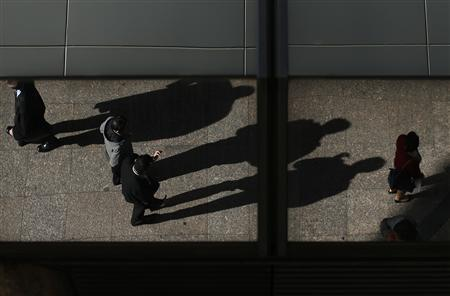 Office workers are reflected on a building as they cast their shadows during lunch time in central Sydney July 30, 2013. REUTERS/Daniel Munoz