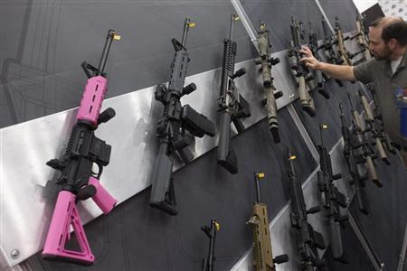 A pink assault rifle hangs among others at an exhibit booth at the George R. Brown convention center, the site for the National Rifle Association's (NRA) annual meeting in Houston, Texas May 5, 2013. REUTERS/Adrees Latif