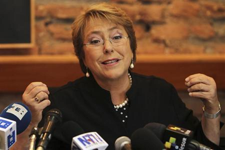 Former Chilean President and current presidential candidate Michelle Bachelet speaks during a news conference to members of the media at her headquarters in Santiago, August 13, 2013. REUTERS/Mario Ruiz/Pool