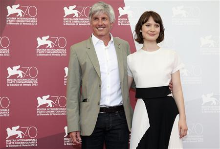 Director John Curran (L) and actress Mia Wasikowska pose during a photocall during the 70th Venice Film Festival in Venice August 29, 2013. REUTERS/Alessandro Bianchi