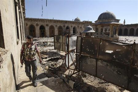 A Free Syrian Army fighter walks inside the Grand Umayyad mosque in Aleppo July 8, 2013. Picture taken July 8, 2013. REUTERS/Muzaffar Salman