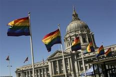 Rainbow colored flags fly outside City Hall in San Francisco, California June 28, 2013. REUTERS/Robert Galbraith