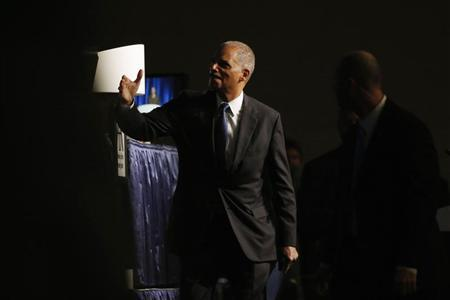 U.S. Attorney General Eric Holder gestures as he exits after speaking at the annual meeting of the American Bar Association in San Francisco, California August 12, 2013. REUTERS/Stephen Lam