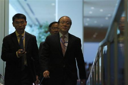 China's ambassador to the United Nations (U.N.) Liu Jieyi (R) exits a meeting of the five permanent U.N. Security Council members at the United Nations Headquarters in New York, August 29, 2013. REUTERS/Brendan McDermid